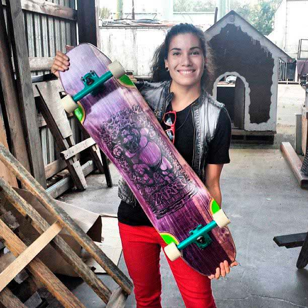 Carmen showing off her purple Hippo board